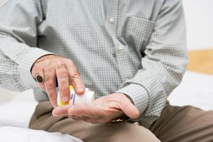 Man taking medication --- Image by © Royalty-Free/Corbis
